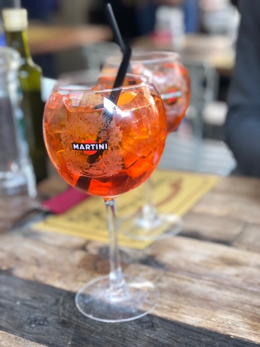 One must enjoy and Aperol Spritz outside!