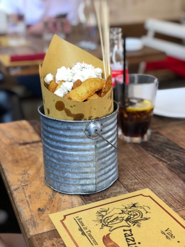 French fries with cheese and pepper